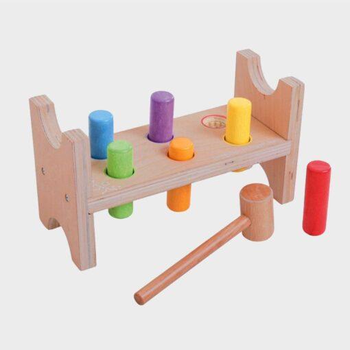 ξύλινο παιχνίδι πάγκος με κυλίδρους και σφυρί